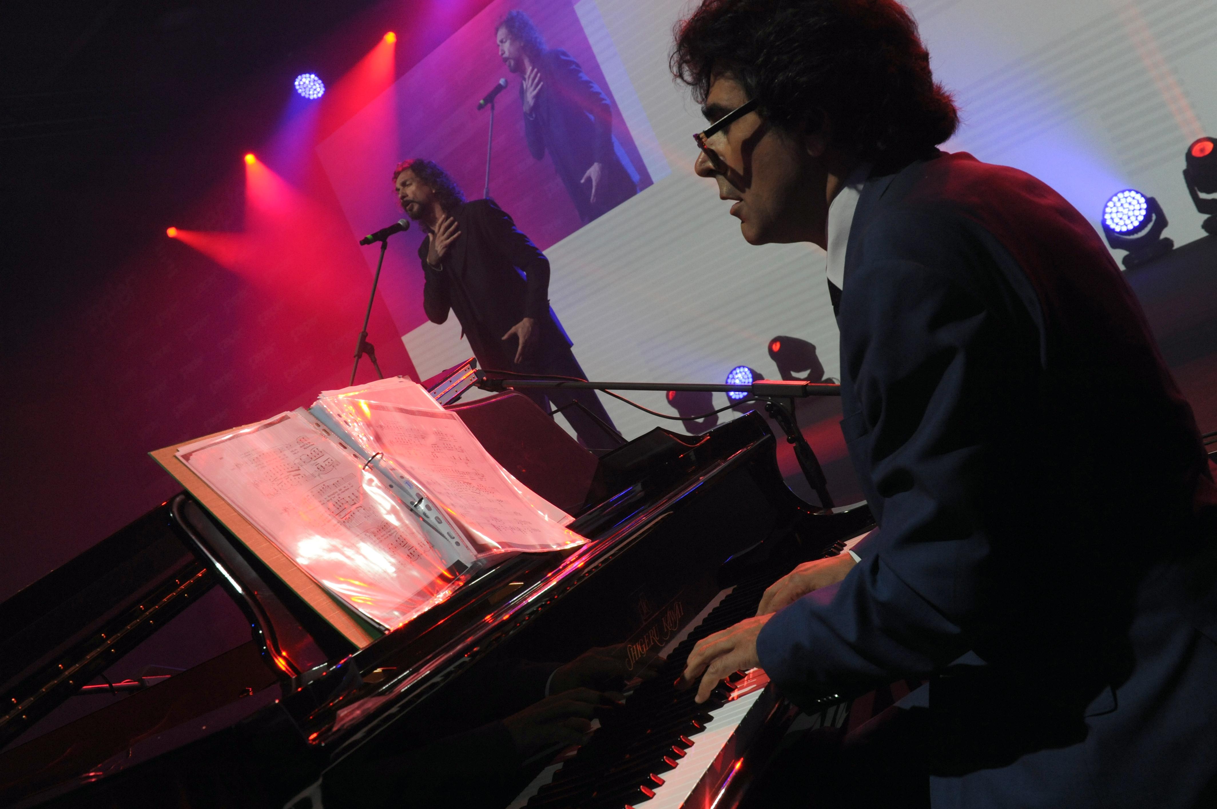 famous conducor of orchestra maestro alberto veronesi to the piano